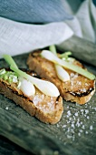 Spring onion and coarse salt on toast