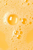 Close-up of beaten egg yolks with bubbles