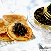 Mini blinis with caviar