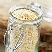 Small glass jar of sesame seeds