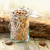Small glass jar of pink lentils