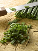 Cutting the chives on the chopping board
