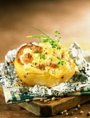 Baked potato filled with cantal cheese