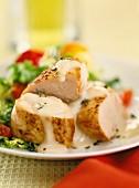 Pork fillet on a bed of salad with a light sauce