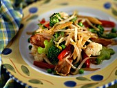 Stir-fried chicken with vegetables and soya sprouts