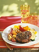 Grilled ostrich steak with vegetables
