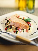 Steamed salmon on a bed of vegetable tatar