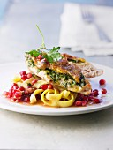 Roast guinea-fowl breast with herb butter and pomegranate