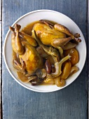 Quail tajine with little artichokes and dried fruit