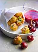 Ricotta and broad bean fritters with cherry coulis