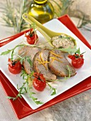 Cold roast pork with cherry tomatoes