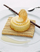 Lemon cream dessert on a bayadere almond-flavored sponge cake