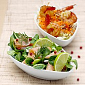 Lamb's lettuce salad with salmon and shrimp salad with sesame and ginger