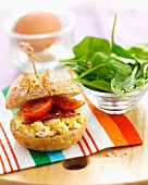 Small scrambled egg, tomato, bacon and spinach shoot salad sandwich