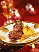 Thick flank of venison with braised pears