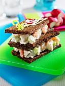 A prawn sandwich on black bread
