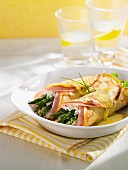 Stuffed pancakes with ham, cream cheese and green asparagus