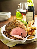 Roast saddle of lamb roulade with a mustard crust