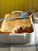 Meat and vegetable bake topped with pastry