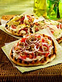 Pizza with green olives, tomatoes, red onions and mozzarella