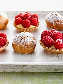 Cream profiteroles and raspberry tartlets