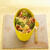 Pasta salad with farfalle and dry-cured ham