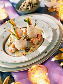 Sole rolls with vegetables, seafood and sea urchin sauce