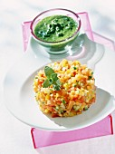 Timbale made from diced tomatoes, peppers, cucumber, carrots and onions served with a mint sauce