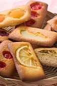 Various Financiers (French almond sponge cakes) with fruit