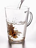 Star anise in a glass of boilng water