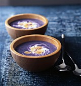 Vitelotte potato soup with cream and sliced almonds