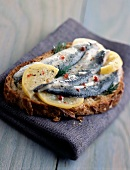 Marinated fresh sardines with confit lemon open sandwich