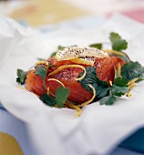 Thick piece of raw salmon with poppy seeds and coriander