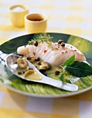 Steam-cooked piece of cod with aromatic herbs