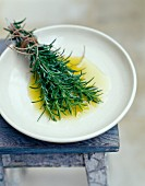 Brush made with rosemary dipped in olive oil