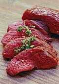 Raw ostrich steaks