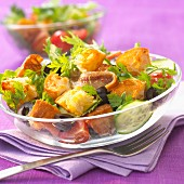 Mixed salad with bread and herrings