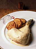 Leg of poultry and cream Fricassée with small potato galettes