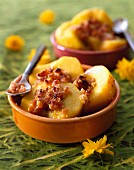 Peaches filled with crushed macaroons and pine nuts