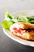 Breaded escalope with mozzarella and raw ham,spinach and rocket salad