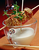 Sesame chicken brochettes with yoghurt sauce