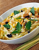 Macaronis with seafood broth and candied fruit