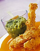 Chicken and almond nuggets and a bowl og guacamole