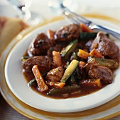 Lamb sauté with carrots and zucchinis