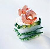 Bloc of frozen vegetables and shrimps