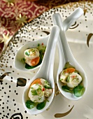 Spoonsful of marinated scallops with herbs and lime