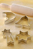 Different shaped biscuit cutters and rolling pin