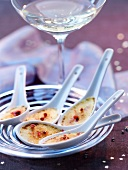 Aperitif spoons of Creme brulée with red pepper