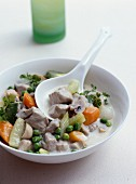 Blanquette de veau (veal fricassee, France) with young vegetables