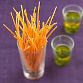 Fried spaghettis with basil sauce